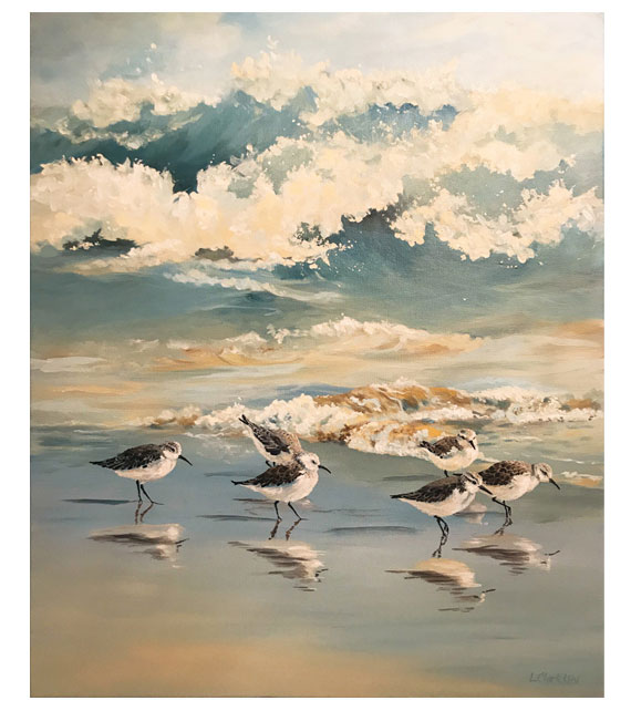 acrylic on canvas of sandpipers running on the beach